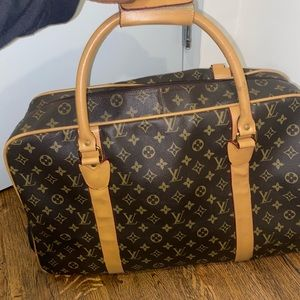 Louis Vuitton travel bag with wheels